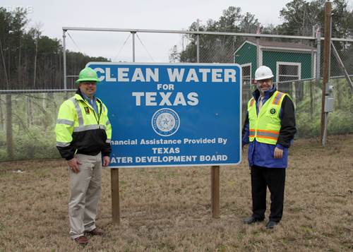 Phil Smith, (left) construction manager for the San Jacinto River Authority's technical services department, stands with Texas Water Development Board Chairman Carlos Rubinstein (right), at the construction site of one of the river authority's projects to develop adequate surface water supplies. The board provided financial assistance for the project.