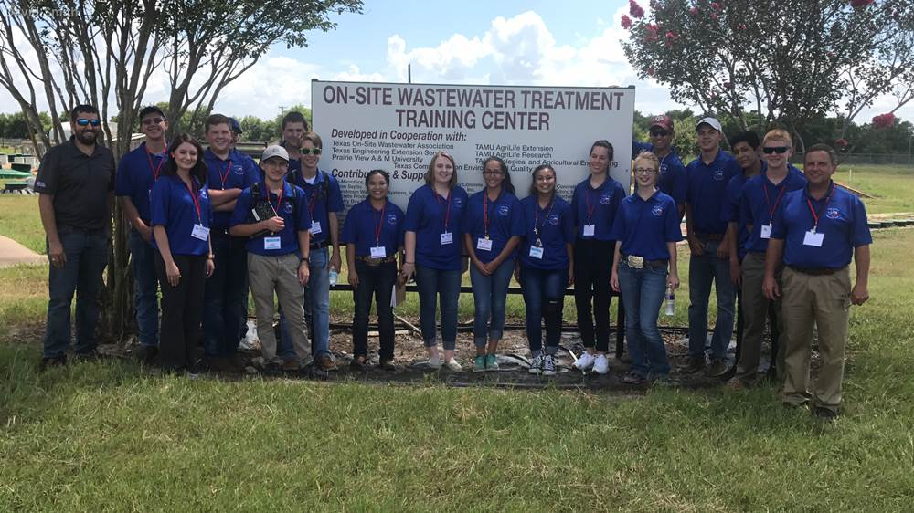 David Smith (far right) leading a group of 4-H Water Ambassadors on a tour of the Texas A&M On-site Wastewater Treatment Training Center on the RELLIS campus.